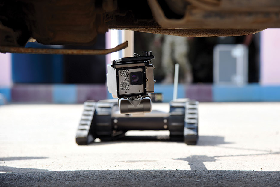 iRobot 510 PackBot searches for explosive devices under vehicle in Djibouti (U.S. Air Force/Maria Bowman)