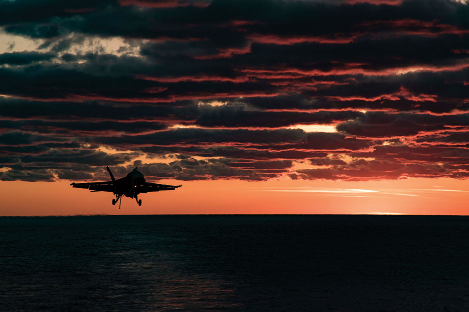 F/A-18E Super Hornet assigned to Gunslingers of Strike Fighter Squadron 105 prepares to make arrested landing on flight deck of aircraft carrier USS Dwight D. Eisenhower, April 9, 2017 (U.S. Navy/Anderson W. Branch)
