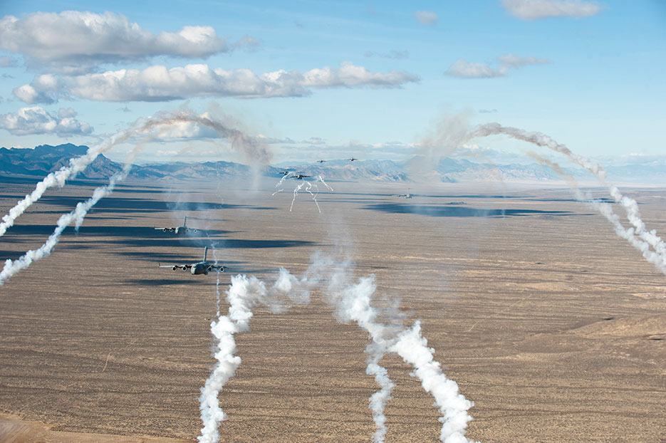 C-17 Globemaster IIIs deploy flares December 6, 2014, while flying over Nevada Test and Training Range during U.S. Air Force Weapons School's Joint Forcible Entry Exercise 14B (U.S. Air Force/Thomas Spangler)