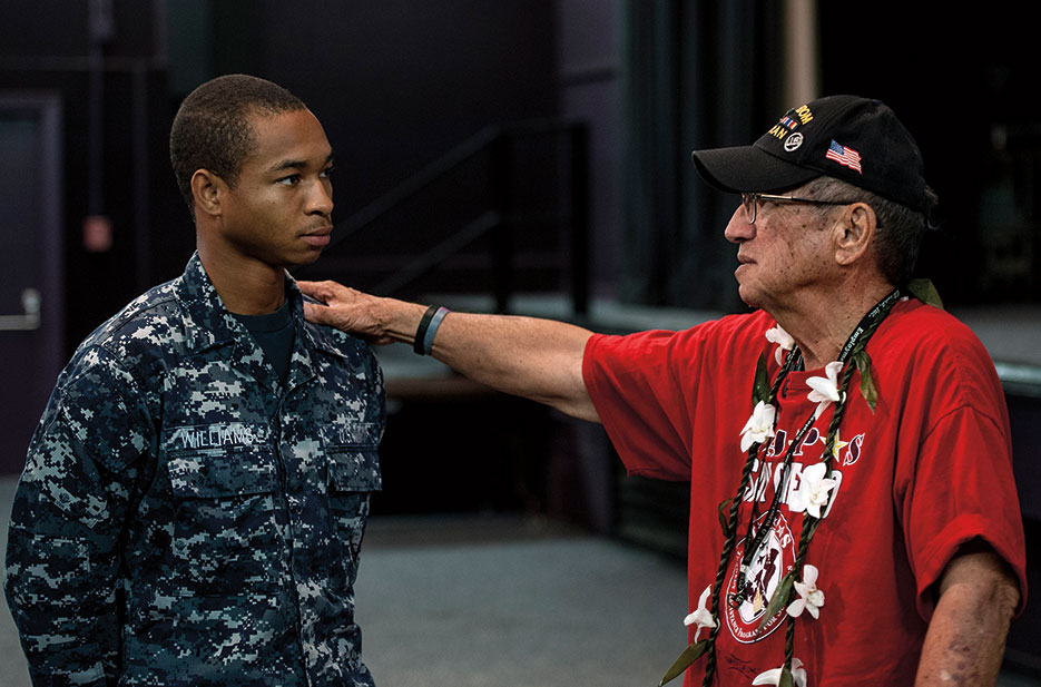 Retired Soldier and member of Statewide Prevent Suicide Hawaii Taskforce speaks to Seaman after suicide prevention seminar on Joint Base Pearl Harbor–Hickam, September 24, 2013 (U.S. Navy/Diana Quinlan)