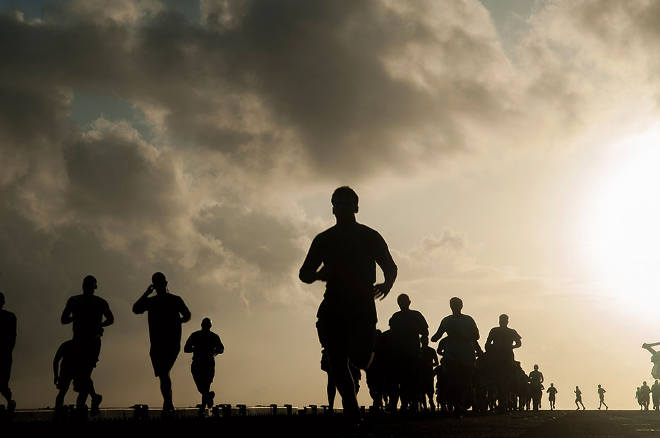 Marines and Sailors aboard amphibious assault ship USS Makin Island run Sexual Assault Awareness and Prevention Month 5K on flight deck, April 21, 2017 (U.S. Navy/Clark Lane)