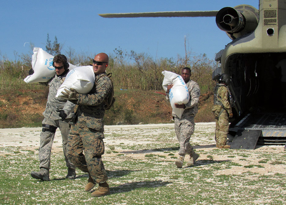 Members of U.S. Southern Command–directed team Joint Task Force–Matthew provide humanitarian and disaster relief assistance to victims of Hurricane Matthew, Jeremie, Haiti, October 8, 2016 (U.S. Marine Corps, South/Adwin Esters)