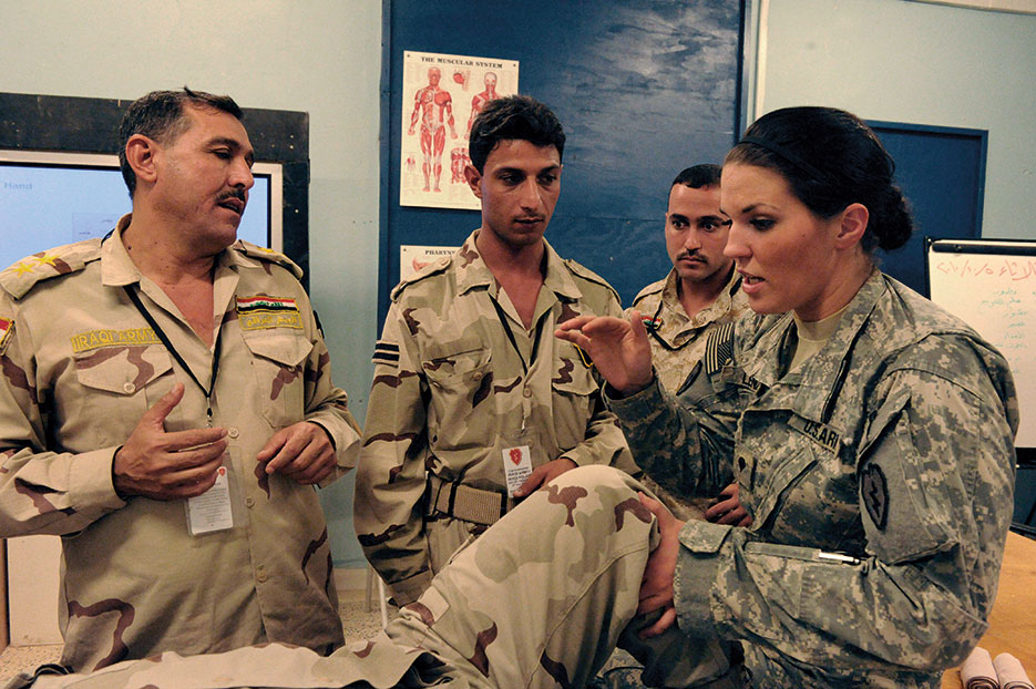 Combat medic (right) with Charlie Company, 225th Brigade Support Battalion, 2nd Advise and Assist Brigade, 25th Infantry Division, teaches Iraqi soldiers how to splint broken leg at Forward Operating Base Warhorse, Diyala Province, Iraq, October 5, 2010 (DOD/Brandon D. Bolick)