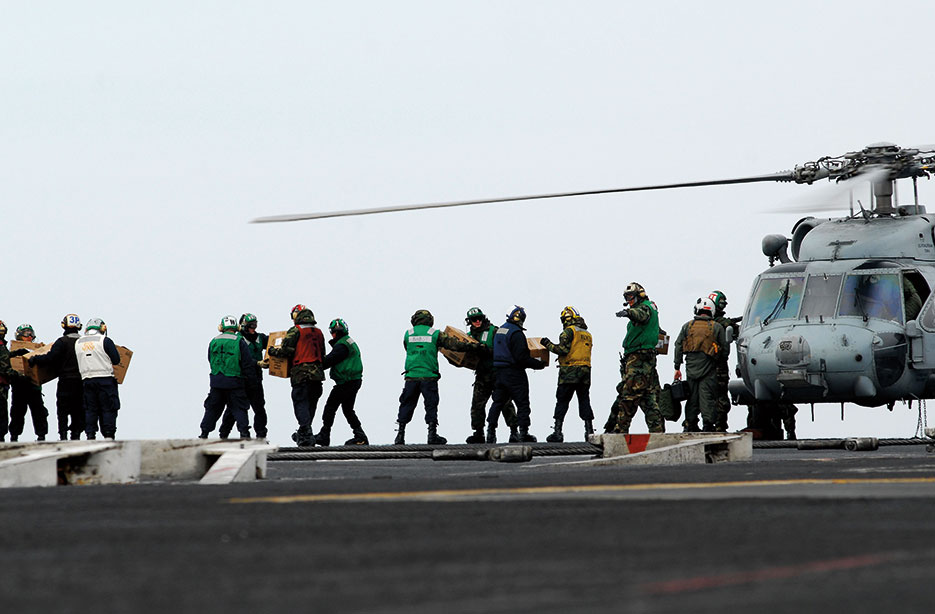 Sailors aboard aircraft carrier USS Ronald Reagan provide humanitarian assistance to Japan as directed in support of Operation Tomodachi, March 15, 2011 (U.S. Navy/Michael Feddersen)