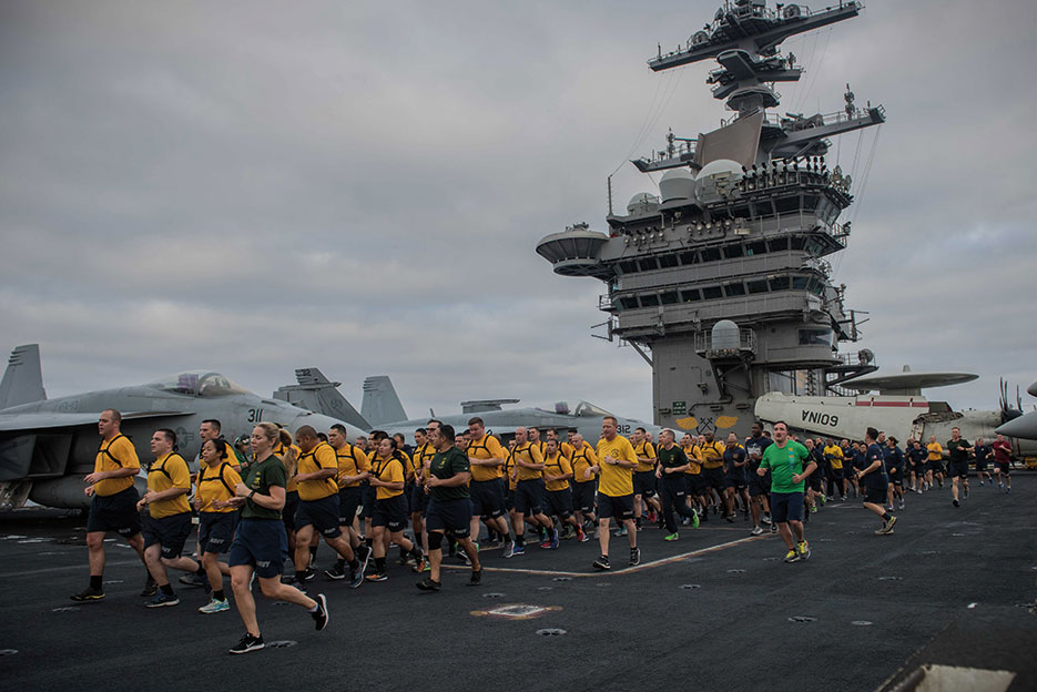 Chief selects run in formation during Applied Suicide Intervention Skills Training 5k run on flight deck of aircraft carrier USS Theodore Roosevelt, August 17, 2017 (U.S. Navy/Alex Perlman)