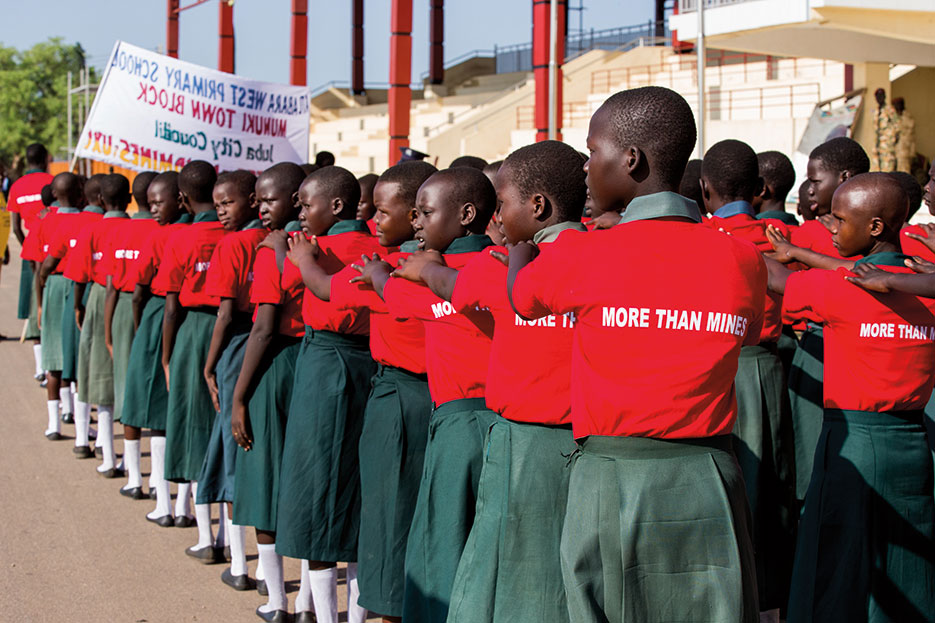 Students march to Nyakuron Cultural Center in Juba, South Sudan, April 2, 2015, during International Day for Mine Awareness and Assistance in Mine Action (Courtesy UN/JC McIlwaine)