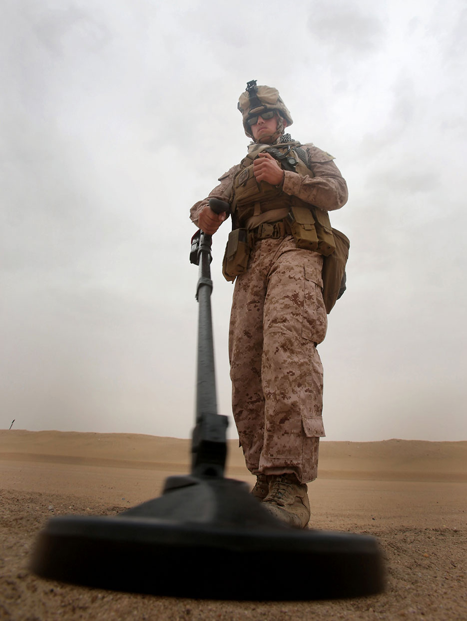 Marine sweeps for signs of improvised explosive devices during training aboard Camp Buehring, Kuwait, November 1, 2013 (U.S. Marine Corps/Christopher O'Quin)