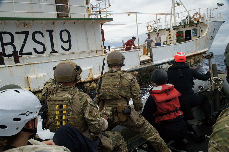 As part of USS Sampson Oceania Maritime Security Initiative mission, U.S. Navy Sailors and U.S. Coast Guard Pacific Law Enforcement Detachment Team personnel approach Chinese fishing vessel, November 29, 2016 (U.S. Navy/Bryan Jackson)