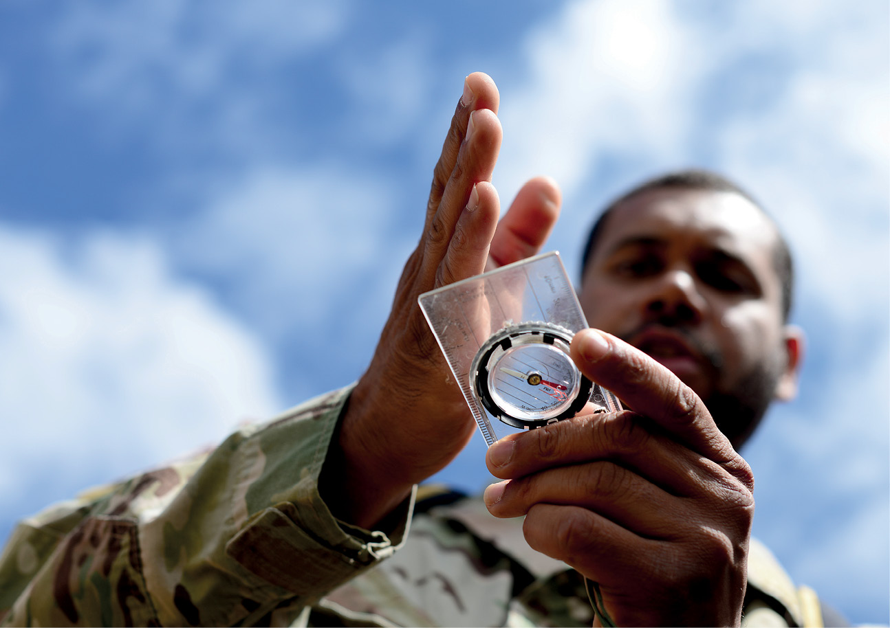U.S. Air Force survival evasion resistance and escape specialist air advisor, with 818th Mobility Support Advisory Squadron, demonstrates navigation skills for Kenyan Defense Force members, Laikipia Air Base, Kenya, June 23, 2016 (U.S. Air Force/Evelyn Chavez)