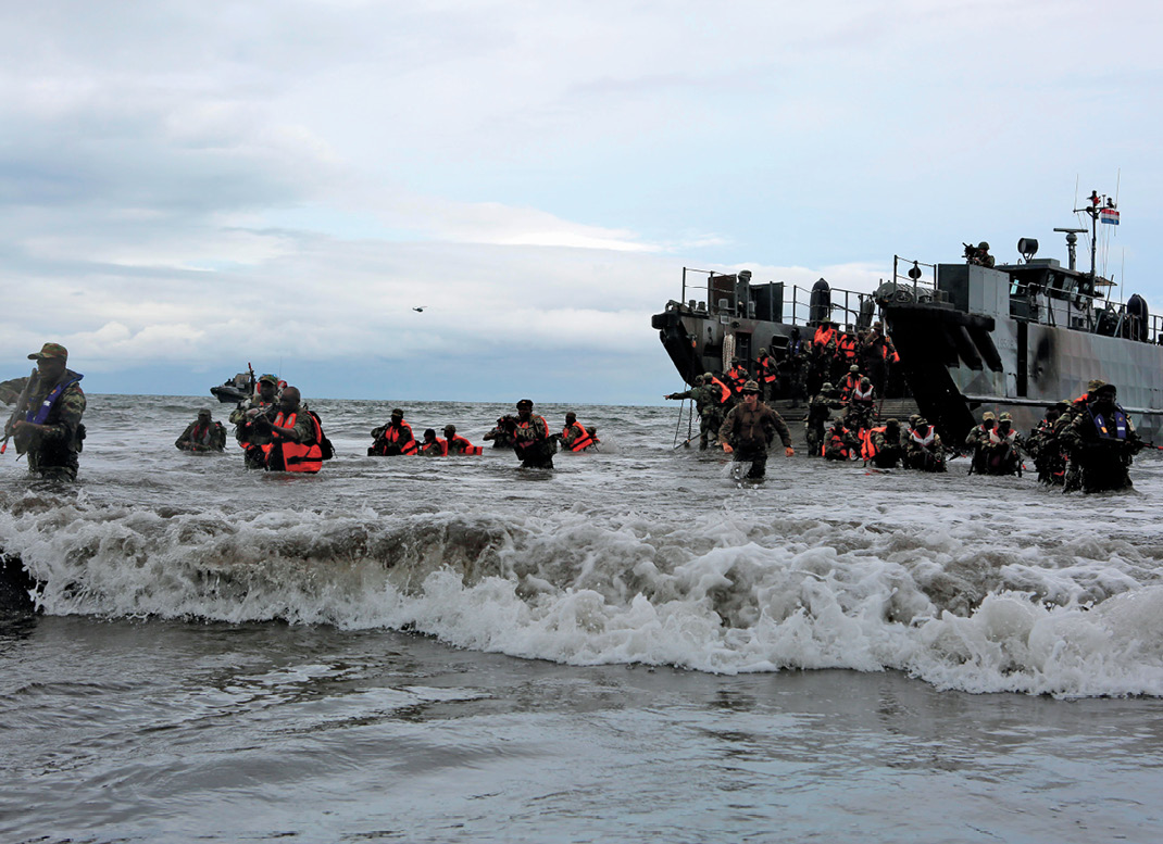 Cameroonian soldiers, along with U.S. and Spanish marine advisors assigned to Africa Partnership Station 13, simulate amphibious assault in jungle as part of final exercise, Limbe, Cameroon, October 2013 (U.S. Marines/Tatum Vayavananda)