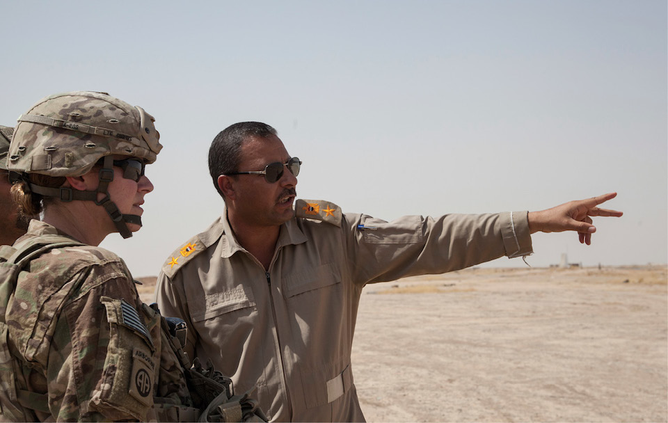 Iraqi soldier speaks with commanding officer of 407th Brigade Support Battalion, 2nd Brigade Combat Team, 82nd Airborne Division, deployed in support of CJTF–Operation Inherent Resolve, near Qayyarah West Airfield, Iraq, July 23, 2017 (U.S. Army/Rachel Diehm)