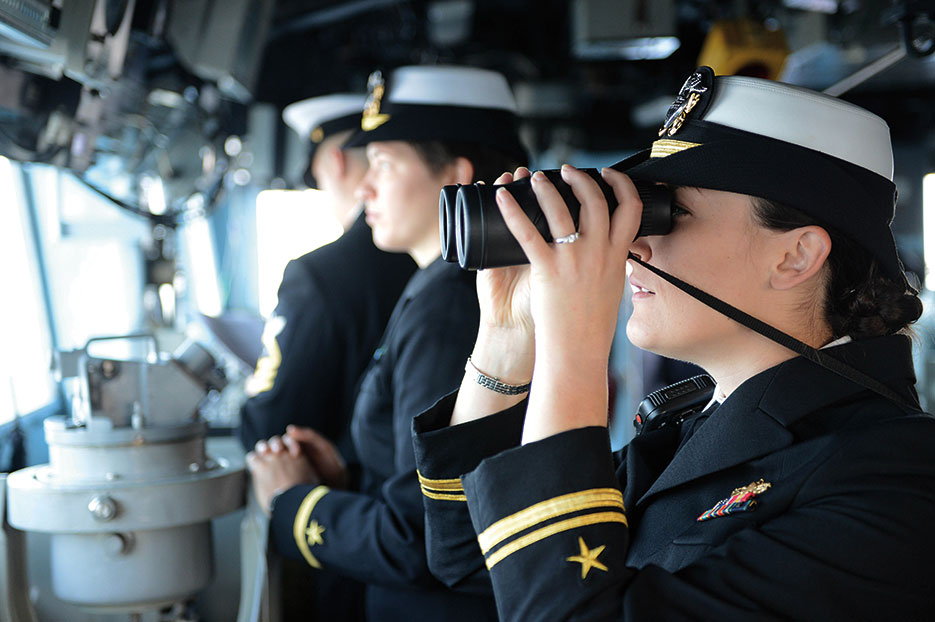 Lieutenant j.g. Stephanie Conte, USN, right, assigned to guided-missile cruiser USS <i>Antietam</i> (CG 54), stands watch as officer of the deck in bridge as ship arrives in Busan, South Korea, October 2013 (DOD/Declan Barnes)