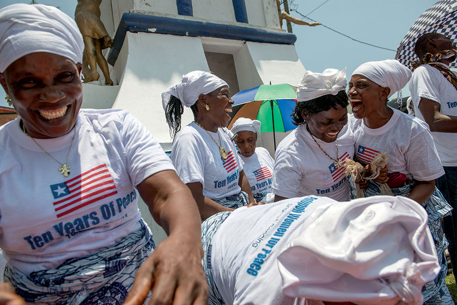 Women in Peace-building Network (WIPNET) members sing for visitors outside 10<sup>th</sup> anniversary celebrations of Comprehensive Peace Accord in Monrovia, Liberia, August 2013 (UNMIL/Staton Winter)