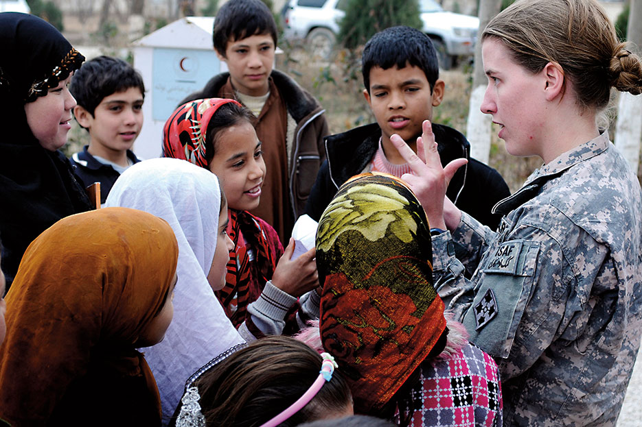 1st Lt. Rebecca Wagner, USA, effects coordinator and Female Engagement Team officer in charge, counts with Afghan children of the Red Crescent Society orphanage and school (U.S. Army/Jeanita C. Pisachubbe)