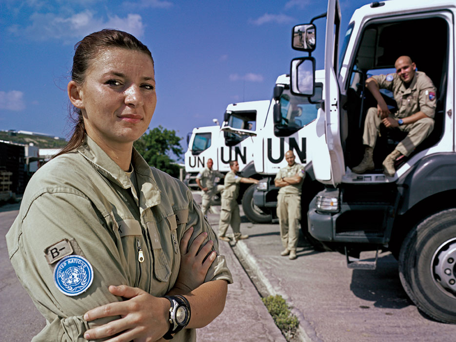 Master Corporal Larissa Pollak, Austrian Contingent, which is in charge of transport operations in United Nations Interim Force in Lebanon, with teammates at headquarters, Naqoura, Lebanon, September 2012 (United Nations)