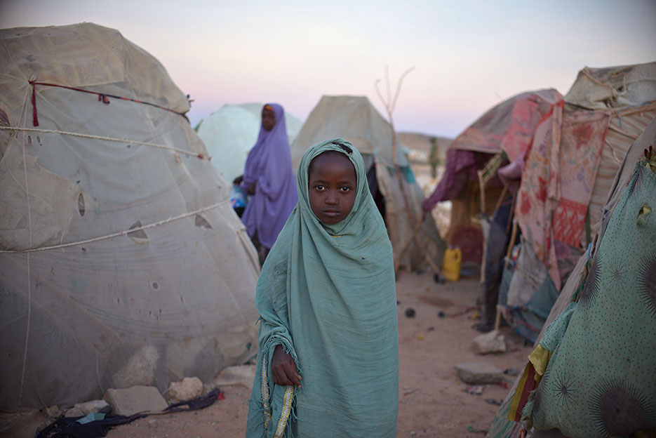 Girl stands on outskirts of camp for internally diplaced persons outside of Belet Weyne, Somalia (United Nations/Tobin Jones)