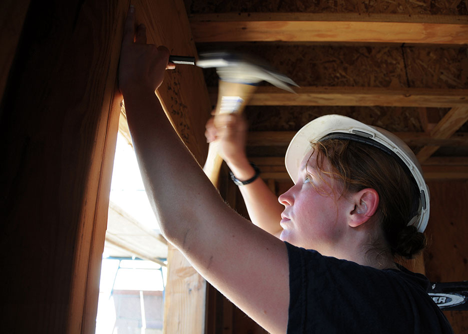 Cryptologic Technician (Technical) 2<sup>nd</sup> Class Lisa Quincy working at Habitat for Humanity project in Lawndale, California, supported by volunteer efforts of several USS <i>Abraham Lincoln</i> (CVN 72) Sailors (U.S. Navy/Zachary A. Hunt)