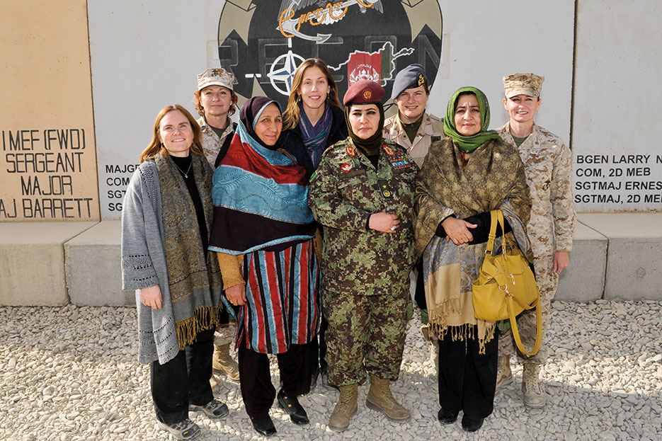 Afghan National Army Brigadier General Khatol Mohammadzai stands alongside other members of both military and civilian services at Regional Command Southwest (Courtesy Royal Air Force/Paul Oldfield)