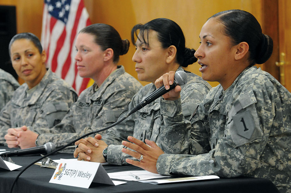 "Sergeant Michallie Wesley, USA, answers question during an interactive discussion on the theme of ""Women Serving in Combat"" at Camp Liberty, Iraq, March 2011 (U.S. Army/Jennifer Sardam)"