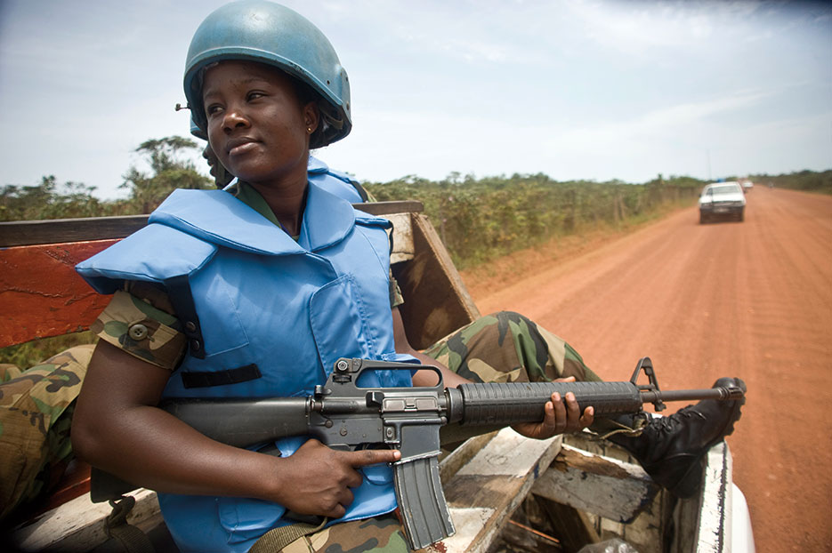 Female members serving with Ghanaian battalion of the United Nations Mission in Liberia on patrol in port city of Buchanan (United Nations/Christopher Herwig)