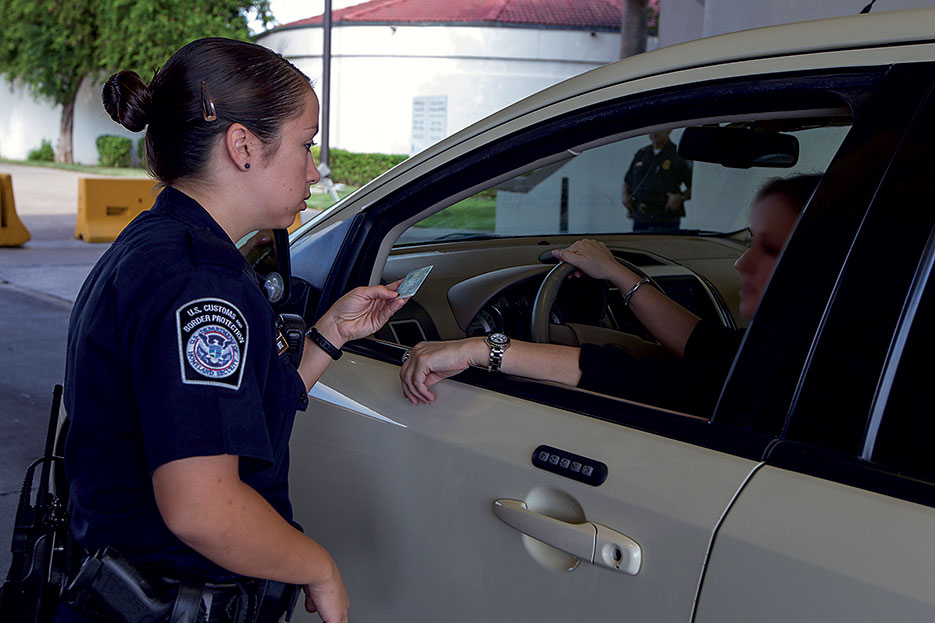 South Texas Customs and Border Patrol officer inspects inbound vehicles and checks identification at Juarez Lincoln Bridge port of entry in Laredo, Texas (U.S. Customs and Border Patrol/Donna Burton)