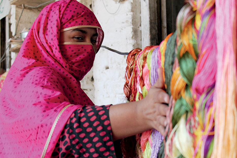 Swati stitch embellishers use exotic colors and patterns in combination with meticulous stitch counting and age-old ingenuity, Swat, Pakistan, October 2012 (USAID)