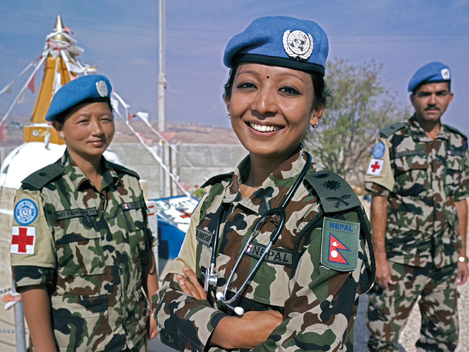 Peacekeeper Captain Dr. Barsha Bajracharya with two nurses at UN Post 8-30, Nepalese Headquarters, near the town of Shakra, South Lebanon, October 2012 (UNIFIL/Pasqual Gorriz)