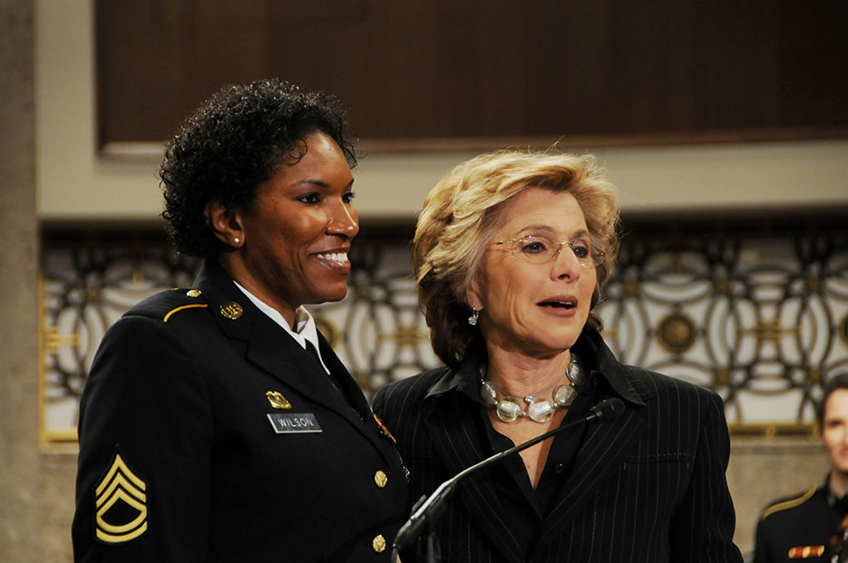 Senator Barbara Boxer of California, right, presents Senate Resolution to recognize accomplishments of women in the military to Sergeant First Class Juanita Wilson, a wounded warrior, during Joint Services Women's History Month Observance on Capitol Hill, March 2010 (U.S. Army)