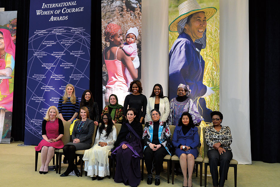 First Lady Michelle Obama, Deputy Secretary Heather Higginbottom, and U.S. Ambassador-at-Large for Global Women's Issues Catherine Russell with 2014 Secretary of State's International Women of Courage Awardees, Washington, DC, March 2014 (State Department)